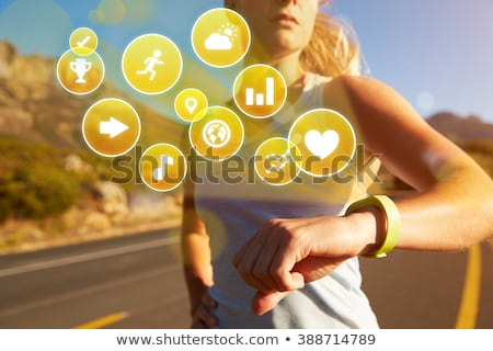 woman with fitness tracker exercising outdoors Stock photo © dolgachov