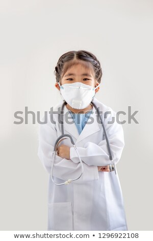 Stock photo: Little girl in doctor costume with pills
