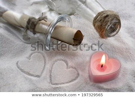 Deux bougies sable brûlant bol envoyer Photo stock © fama