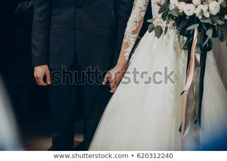 stylish bride and groom are holding bridal bouquet Stock photo © ruslanshramko
