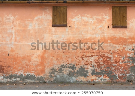 windows on red wall in old house stock photo © vapi