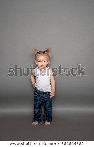 group of happy children in studio gray background stock photo © lopolo