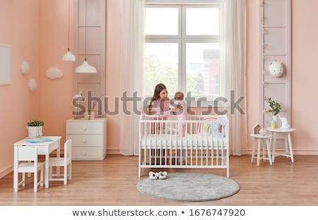 bébé · éveillé · fille · heureux · lit - photo stock © lopolo