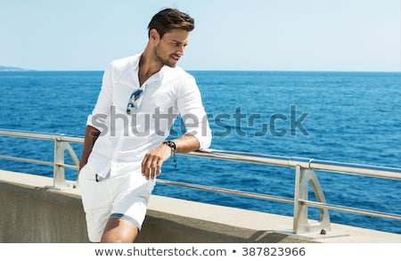 portrait of relaxed handsome man wearing blue shirt stock photo © feedough