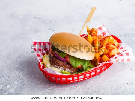 Fresh beef burger with sauce and vegetables and potato chips fries on stone kitchen table background Stock photo © DenisMArt