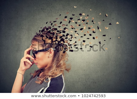 Side profile of a woman losing parts of head as symbol of decreased mind function Stock photo © ichiosea