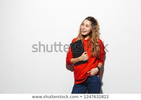 Photo stock: Image Of Joyful Woman 20s Wearing Red Sweatshirt Holding Laptop