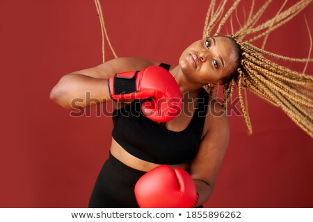 Portrait of an afro american pretty young sportswoman stock photo © deandrobot