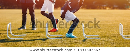 Winter Football Soccer Training Session with Hurdles Stock photo © matimix