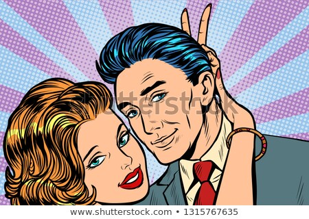 woman puts horns to man, hand gesture joke Stock photo © studiostoks