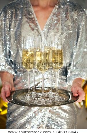 Close up of shiny glasses of champagne over black, white, golden Stock photo © dashapetrenko