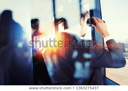 Businessman looks far for new job opportunities with binoculars. Double exposure effect Stock photo © alphaspirit