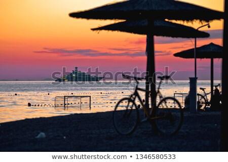 Playa colorido puesta de sol grande yate vista Foto stock © xbrchx