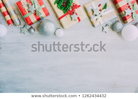 christmas background with confetti christmas balls and red gift boxes on the white wooden board stock photo © abstractvanilla