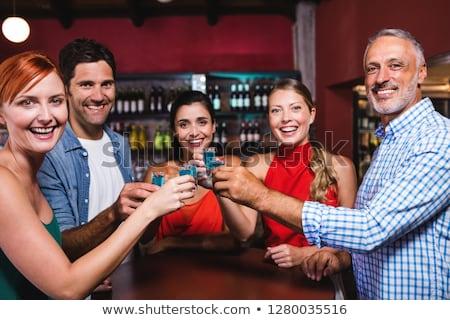 Barátok pirít tequila szemüveg csoport derűs Stock fotó © AndreyPopov