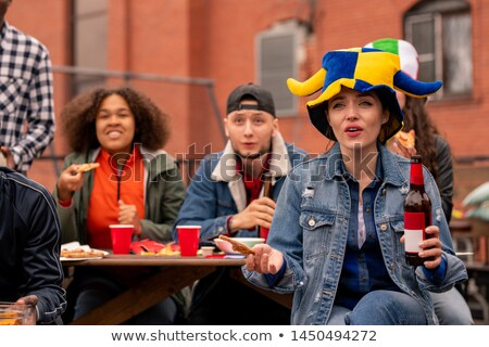 Group of young tense friendly football fans watching broadcast at leisure Stock photo © pressmaster