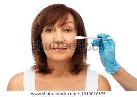 Starszy kobieta chirurg ręce skalpel piękna Zdjęcia stock © dolgachov