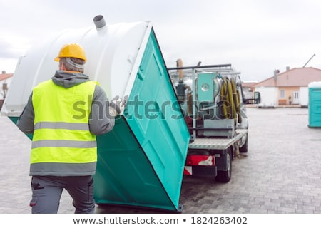 Rental lavatory being loaded on truck Stock photo © Kzenon