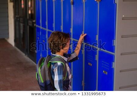 вид сбоку Cute кавказский школьник открытие ящик Сток-фото © wavebreak_media