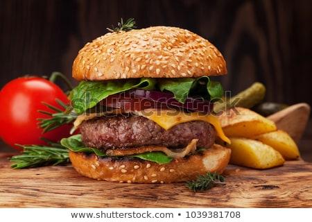 Hamburgerek vágódeszka közelkép étel piros hús Stock fotó © Alex9500