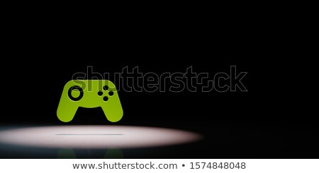 Gamepad Controller Symbol Spotlighted on Black Background Stock photo © make