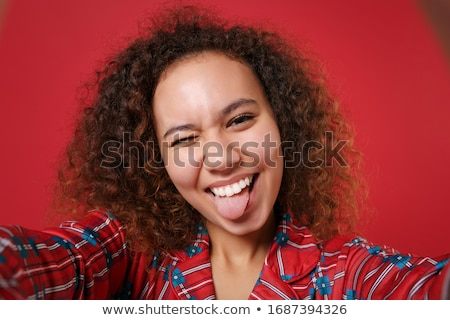 red haired teenage girl taking selfie with tongue Stock photo © dolgachov