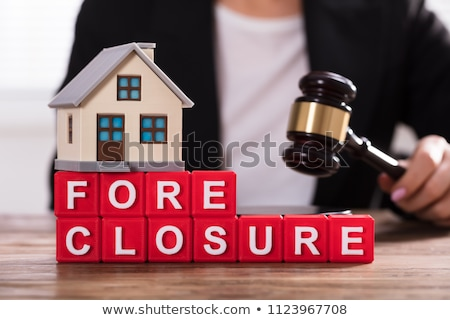 Close-up Of House Model On Foreclosure Cubic Blocks Stock photo © AndreyPopov