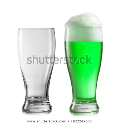 Glass of light green beer with thick foam. Stock photo © artjazz
