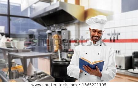Mutlu Hint şef okuma yemek kitabı kebap Stok fotoğraf © dolgachov