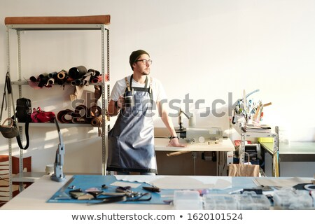 Taking break in leather workshop Stock photo © pressmaster