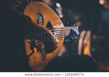 Árabe homem jogar instrumento musical música mão Foto stock © Elnur