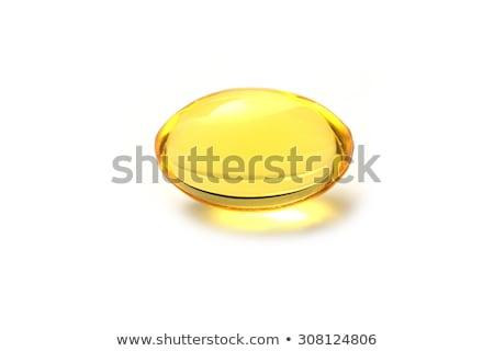 желтый · гель · капсула · изолированный · белый · золото - Сток-фото © stoonn