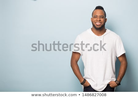 Stock photo: Photo of joyful african american man laughing and looking aside