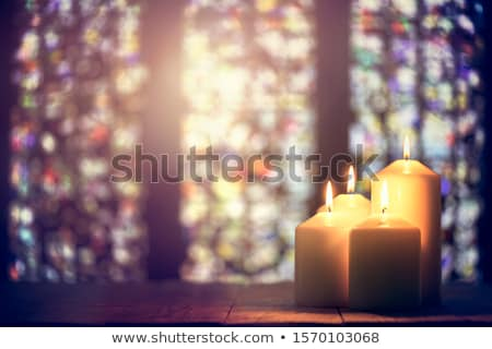 Candles and stained glass in the church Stock photo © borna_mir