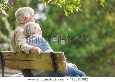 Older couple sitting on a bench Stock photo © photography33
