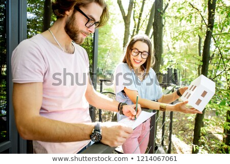 Architect with a family looking at a construction model Stock photo © photography33