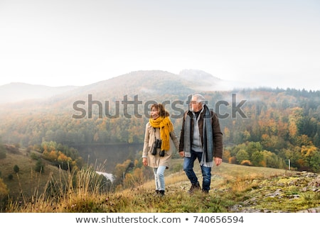 senior couple walking in the forest stock photo © photography33
