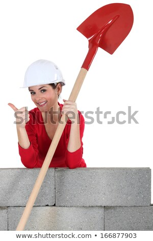 Female bricklayer giving thumbs-up Stock photo © photography33