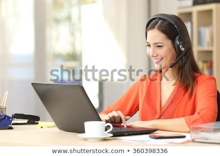 Feminino recepcionista fone computador portátil computador mulher Foto stock © photography33