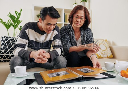 Family looking at photo album Stock photo © photography33