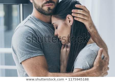 beauitful attractive couple hugging stock photo © stockyimages