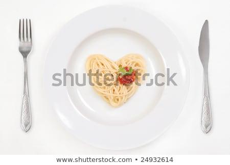 Sevmek makarna spagetti plaka masa örtüsü kalp şekli Stok fotoğraf © Taiga