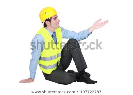 Man sitting down wearing fluorescent jacket Stock photo © photography33