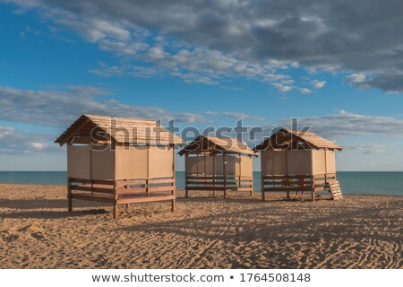 wooden canopy on the sandy beach and blue sky stock photo © vlaru