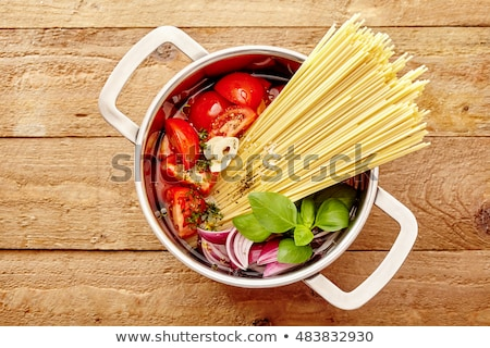 cooking pot with spahetti and ingredient Stock photo © M-studio