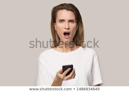 意外 · メッセージ · 笑みを浮かべて · 若い女性 · 読む · スマートフォン - ストックフォト © photography33