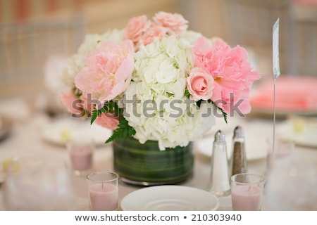 Elegant holiday flower centerpiece, glass vase. stock photo © justinb