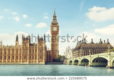 Big Ben Westminster Clock Tower in London with a blue sky. Stock photo © latent