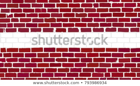 Stock photo: Flag of Latvia on brick wall