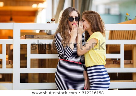 two girls gossiping about another girl Stock photo © photography33